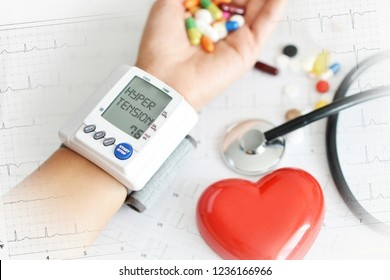 Hypertensive heart disease concept with woman's arm measuring blood pressure