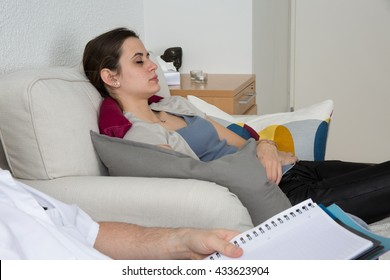 Hypnosis being practiced on a young female patient