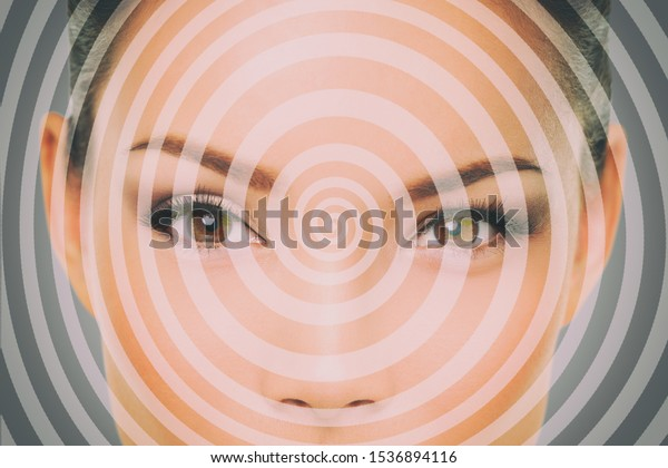 Hypnosis hypnotize spiral over woman face for mind control.
