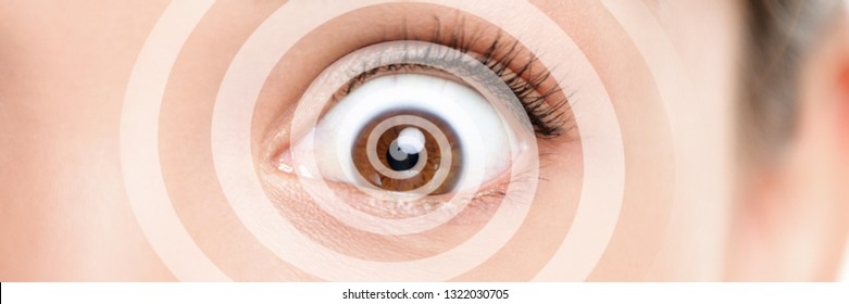 Hypnosis therapy for ocd mental help problems. Closeup of eye with graphic spiral design over eyes of woman hypnotized banner panorama. Asian girl hypnose portrait background.