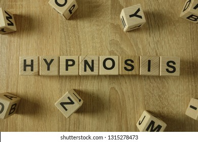 Hypnosis word from wooden blocks on desk