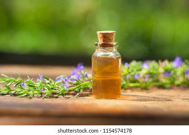 hyssop essential oil in a beautiful bottle on the table