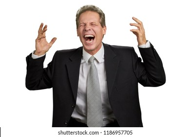 Hysterical laughter of businessman. Man in business suit laughing with raised hands over white background. Human facial expressions.