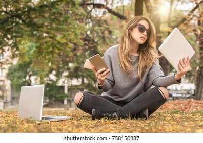 Hysterical young girl with too many screens, mobile phones, tablets and laptops. Too much communications concept. Internet social media. Emotional isolation and technology depresion