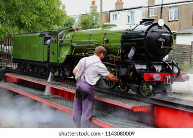 Hythe,Kent/UK 08-01-16 Romney, Hythe and Dymchurch miniature railway. The locomotive Green Goddess at Hythe station. The loco gets some attention on the turntable