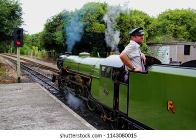 Hythe,Kent/UK 08-01-16 Romney, Hythe and Dymchurch miniature railway. The locomotive Green Goddess at Hythe station. The train gets ready to depart.