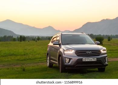Hyundai creta ix25 on the plain among the mountains in the Altai Mountains