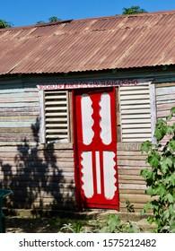 """""""I believe in no one except Jesus Christ"""" above door in rural Dominican Republic"""