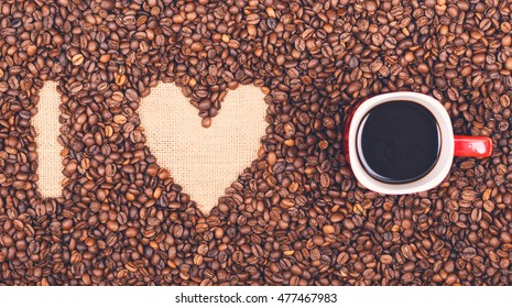"""""""I LOVE COFFEE"""" made of coffee beans and red coffee cup - Flat lay"""