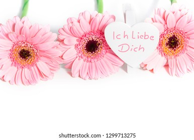 """I love you"" heart and pink gerbera, isolated on white"