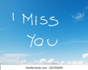 """""""i miss you"""" written in the sky with contrails left by airplane"""