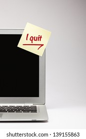 """i quit"" written on sticky note, on laptop screen."