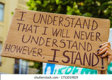 """""""I Understand that I will never Understand"""" Banner in Demonstration March in Protest Against Racial Oppression  Black Lives Matter in Avenida Almirante Reis - Lisbon, Portugal, June, 6, 2020"""