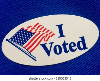 """I voted"" sticker on blue fabric"