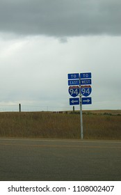 I94 - Road signs on Montana Interstate highway 94 on an overcast day.