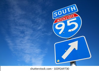 I-95 South Sign in Afternoon Sun Against Blue Sky with Scattered Clouds