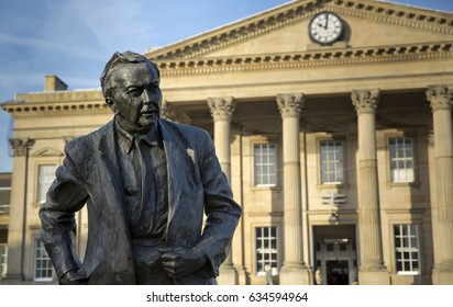 Ian Walter's Statue of former Prime Minister & founder of the Open University, Harold Wilson. Labour Politician, outside Huddersfield Railway Station, the town of his birth, seen on 13th November 2013
