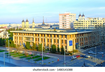 IASI, ROMANIA - APRIL 7, 2019: The Square House, building built during the communist regime, which now houses the County Council and the Prefecture. Morning sunlight.