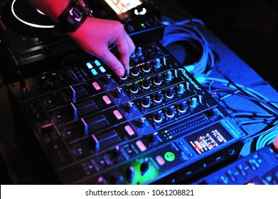 Iasi, Romania - January 15, 2017: Dj hands play on audio mixer in the club.