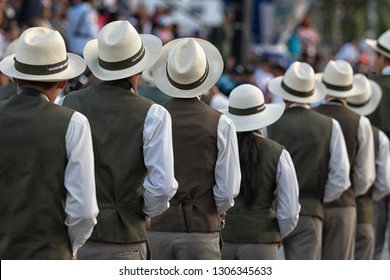 Ibarra, Ecuador-September 21,2018: men's marching band wearing Panama hats at the city founding celebration street parade