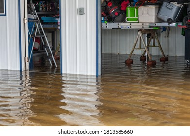 IBERIA PARISH, L.A. / USA - AUGUST 27, 2020: An outdoor structure, carport and shed, submerged in water due to flooding after a natural disaster, hurricane Laura.