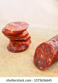 Iberian chorizo, Spanish chorizo ​​or Spanish sausage cut into slices on a wooden board. Typical spanish dish
