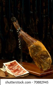 Iberian ham with a plate of slices of ham. Typical Spanish