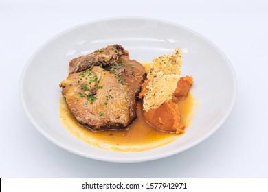 Iberian leg with cava sauce, baked sweet potato and crispy cheese