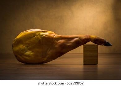 Iberico ham isolated on wood background