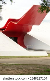 Ibirapuera park, Sao Paulo, Brazil, december 2018. Detail of the main entrance of the Ibirapuera Auditorium in Sao Paulo, Brazil. This characteristic doorway has a curved red futuristic canopy