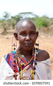 IBISSIL, KENYA-DECEMBER 7, 2010: An unidentified Maasai woman wears traditional clothing and beads in this illustrative editorial.