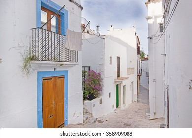 IBIZA, BALEARIC ISLANDS, SPAIN - DECEMBER 15, 2015: White residential buildings in Eivissa Old Town Dalt Vila on December 15, 2015 in Ibiza, Balearic islands, Spain