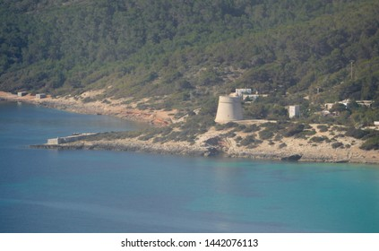 IBIZA, BALEARIC ISLANDS, SPAIN - JUNE, 2019:   Aerial view of Sa Sal Rossa Tower. This defense tower built in the 16th century used to protect the entrance to the Eivissa city from the south.