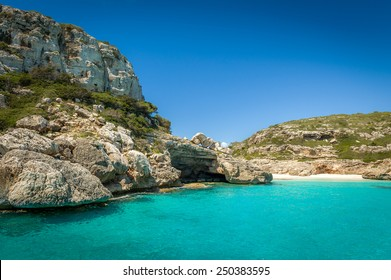 Ibiza bay Cala Marmolis with famous wild sand beach and turquoise water. Baleares, Spain