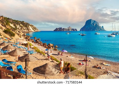 Ibiza Island, Spain - June 12, 2017: Cala d'Hort beach. Cala d'Hort in summer is extremely popular, beach have a fantastic view of the mysterious island of Es Vedra. Ibiza, Balearic Islands. Spain