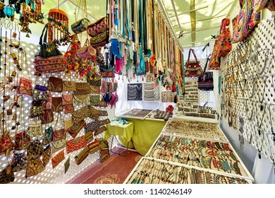 Ibiza Island, Spain - May 2, 2018: Stall full of a handmade fashion accessories, silver jewellery with precious gems and bohemian style of bags in the Hippy market of Ibiza Island. Spain