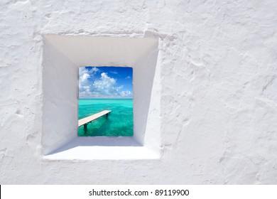 Ibiza mediterranean white wall window with Formentera beach view [photo-illustration]