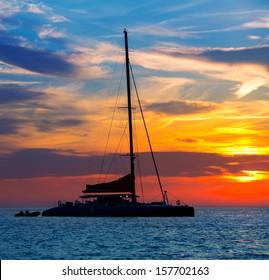 Ibiza san Antonio Abad de Portmany catamaran sailboat sunset with in Balearic islands of spain