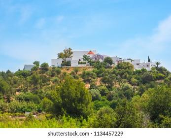 Ibiza, Spain. Hermitage of Santa Eulalia del Rio and typical white houses of Ibiza and vegetation of the island
