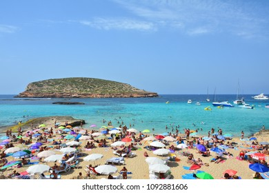 IBIZA, SPAIN - JULY 13, 2017: Tourists relax on Cala Comte, famous beach of Ibiza island
