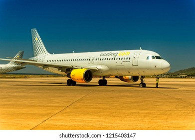 IBIZA, SPAIN, July 16 2018: A ground handling operator is unplugging headphones from the Vueling Airbus A320 at Ibiza International Airport in Ibiza, Spain.