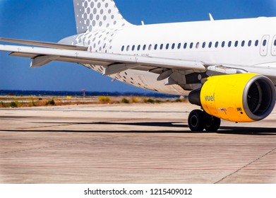 IBIZA, SPAIN, July 16 2018: Rear right side with blast of hot air from the engine of the Vueling Airbus A320 at  Ibiza International Airport, Ibiza, Spain.