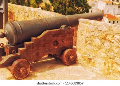 IBIZA, SPAIN, July 18 2018: An old cannon on the walls of The Old Town of Ibiza, at Ibiza, Spain.