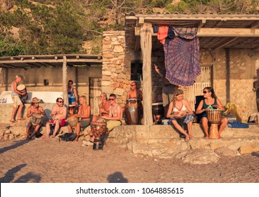 Ibiza, Spain, June 2017. Hippies musicians, playing at sunset, on the beach, cove de Benirras