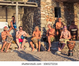 Ibiza, Spain, June 2017. Hippies musicians, playing at sunset, on the beach, cove of Benirras