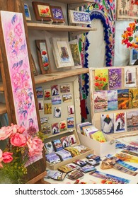 Ibiza, Spain, June 2018. Hippy market of Las Dalias. Hand-painted paintings and flowers, typical of the island