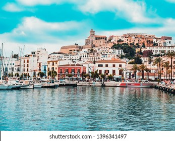 Ibiza, Spain ,June 29, 2018.View of the skyline of the old city of Ibiza called Dalt Vila and the port, in turquoise and red tones, on a cloudy day