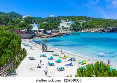 Ibiza, Spain - May 19, 2013:  Tourists in the beach of Cala Xarraca