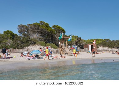Ibiza, Spain - September 07, 2016 : Tourists sunbathing in Ses Salinas beach