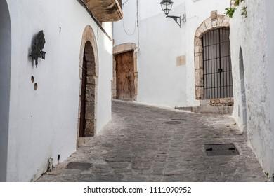 IBIZA-EIVISSA,SPAIN-JANUARY 19,2016: Solitary street, winter day in historic center of Ibiza.